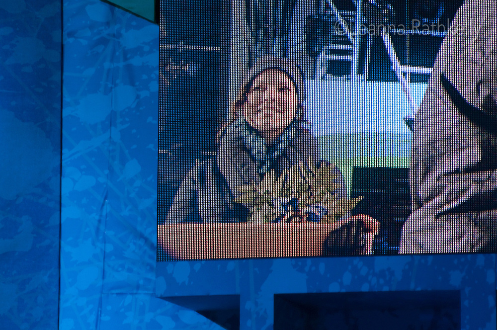 Taylor holds the medals tray at the Victory Ceremonies in Whistler during the 2010 Olympic Winter Games in Whistler, BC Canada.