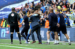 Lyle Taylor of AFC Wimbledon celebrates scoring a goal with his Manager Neal Ardley - Mandatory by-line: Robbie Stephenson/JMP - 30/05/2016 - FOOTBALL - Wembley Stadium - London, England - AFC Wimbledon v Plymouth Argyle - Sky Bet League Two Play-off Final