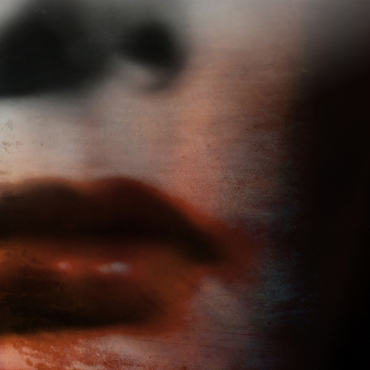 close-up of a woman's lips with smeared lipstick