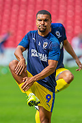 Kwesi Appiah (#9) of AFC Wimbledon warms up before the EFL Sky Bet League 1 match between Sunderland and AFC Wimbledon at the Stadium Of Light, Sunderland, England on 24 August 2019.