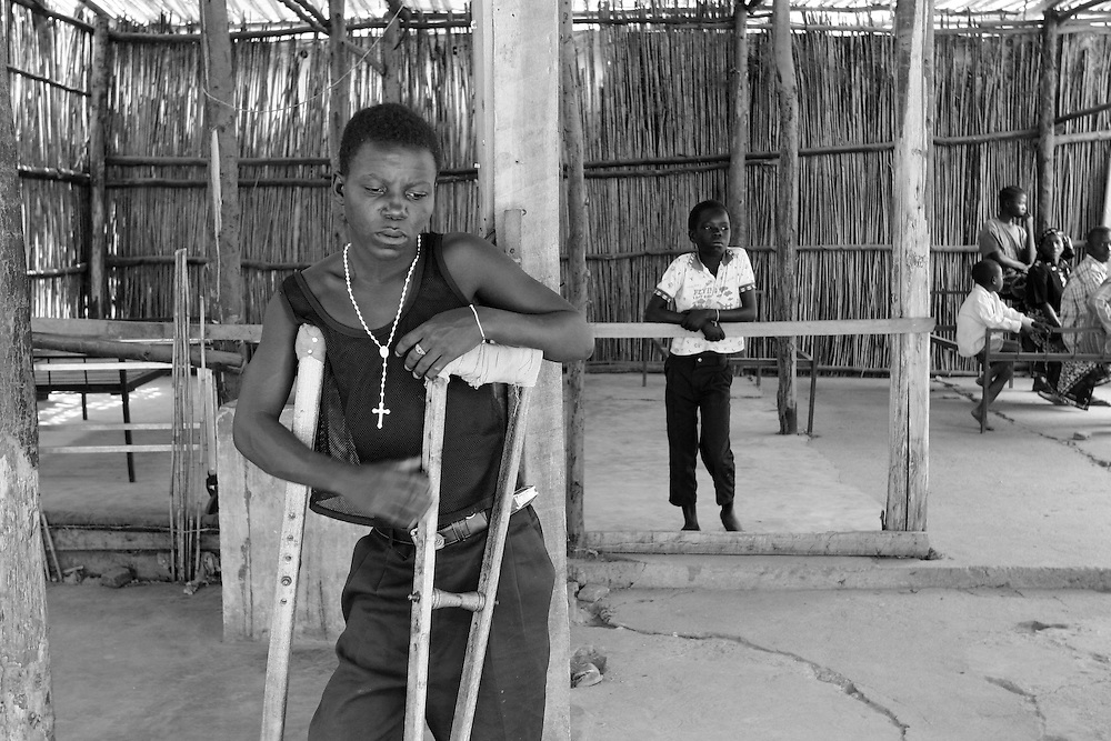 Young boy with crouches at the center for injured people in Bujumbura waiting to be seen by a Doctor from MSF as he was injured in his leg by bullets. @ Martine Perret. 24 October 2005.