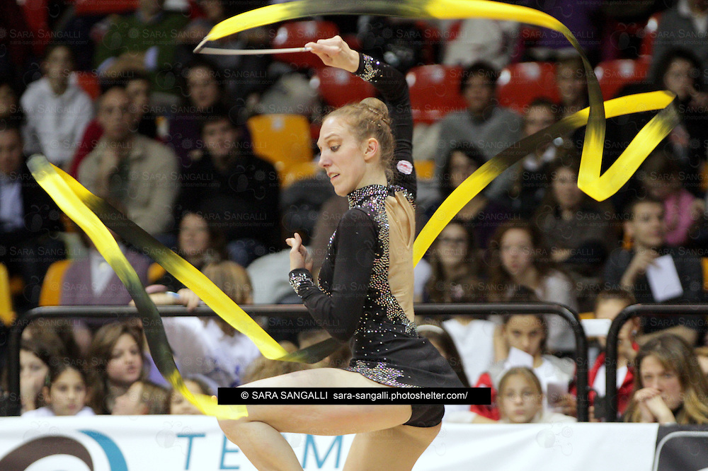 Julieta Cantaluppi of GINNASTICA FABRIANO CERRETO D'ESI performing in a ribbon routine during the 2012 italian Serie A2 rhythmic gymnastic competition.