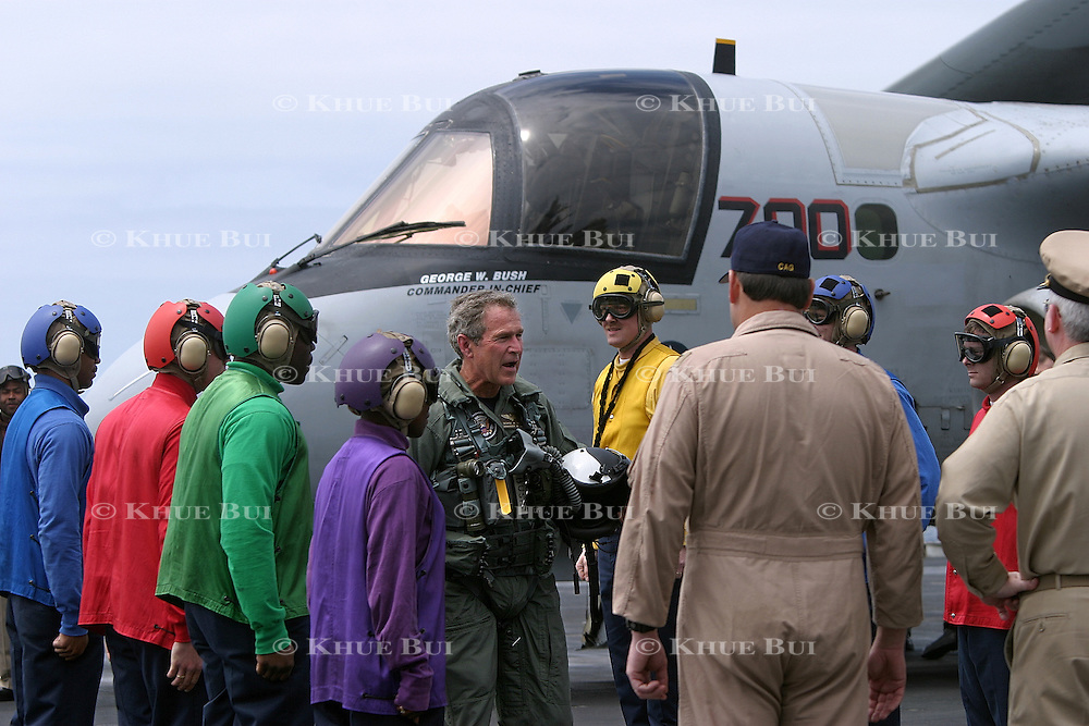 President Bush, wearing his flight suit, walks the flight deck of the aircraft carrier USS Abraham Lincoln after arriving via a US Navy S-3B Viking Thursday, May 1, 2003, in the Pacific Ocean.  Bush traveled to the aircraft carrier USS Abraham Lincoln to meet with returning sailors and to announce and end to 'major combat operations' in Iraq...Photo by Khue Bui