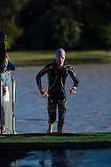 Age Group Competitor comes out of the water at the swim exit. 2012 Ironman Shepparton 70.3 Triathlon. Shepparton, Victoria, Australia. 18/11/2012. Photo By Lucas Wroe