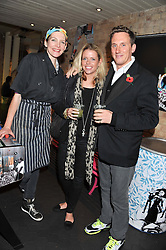 Left to right, THOMASINA MIERS, SCARLETT GUESS and HARRY BECHER at a Mexican Feast cooked by Thomasina Miers in aid of the charity Too Many Women held at Wahaca Soho, 80 Wardour Street, London on 9th November 2011.