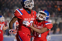 Folsom Bulldogs Joe Ngata (10), celebrates his touchdown with Folsom Bulldogs Elijhah Badger (14), making the score 7-7 after the point after attempt was good during the first quarter as the Folsom High School Bulldogs varsity football team hosts the Central High School Grizzlies in the CIF NorCal Division I-AA title game, Friday Dec 8, 2017. The winner of this game will face the CIF SoCal winner in the State Championship game at Sacramento State, Friday Dec 15th.<br /> photo by Brian Baer