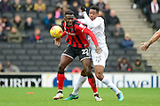 Shrewsbury Town defender Aristote Nsiala (22) battles for possession with Milton Keynes Dons midfielder Chuks Aneke (25) during the EFL Sky Bet League 1 match between Milton Keynes Dons and Shrewsbury Town at stadium:mk, Milton Keynes, England on 25 February 2017. Photo by Dennis Goodwin.