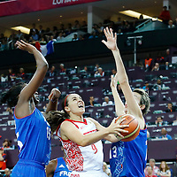 09 August 2012: Russia Becky Hammon goes for the layup past France Jennifer Digbeu and Elodie Godin during 81-64 Team France victory over Team Russia, during the women's basketball semi-finals, at the 02 Arena, in London, Great Britain.