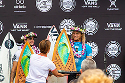 Ricardo Christie of New Zealand finishes in 3rd position and is accepting his trophy for the Hawaiian Pro at Haleiwa, Oahu, Hawaii, USA.