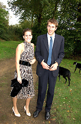 OTIS FERRY and his girlfriend LAURA HUW-WILLIAMS at the wedding of Lucy Ferry to Robin Birley held at Ormsby Lodge, Ham Gate Avenue, Ham, Surrey on 26th October 2006.<br />