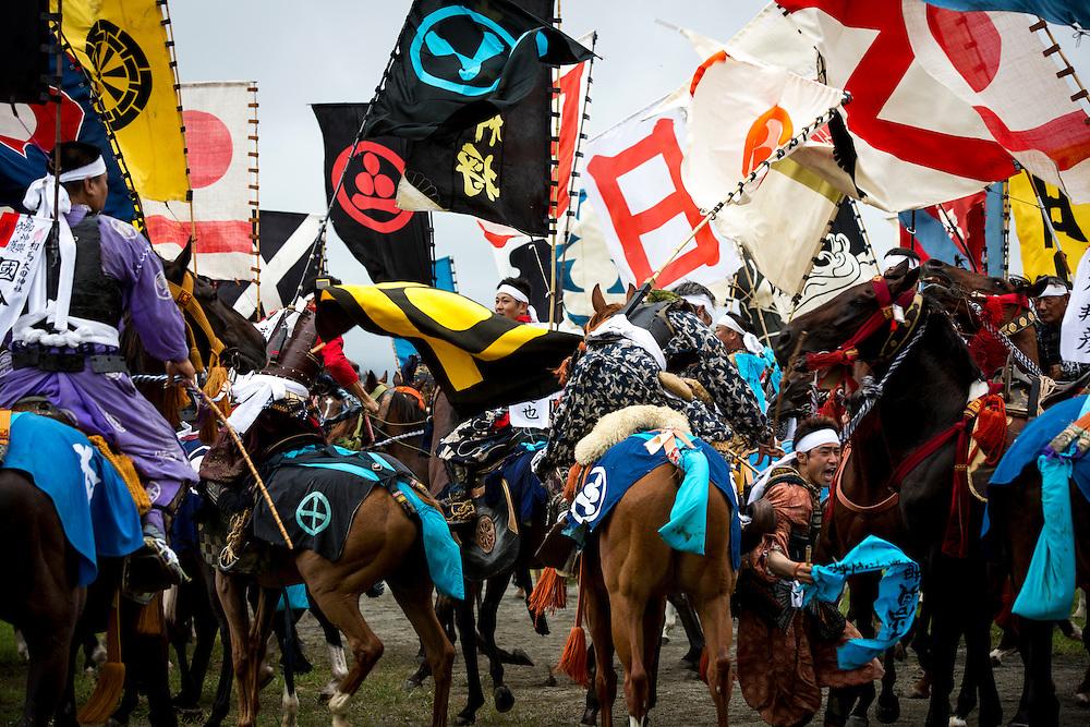 "MINAMISOMA, JAPAN - JULY 24 : A samurai horsemen fight for the sacred flag as they compete in the Shinki-soudatsusen (sacred flag competition) during the Soma Nomaoi festival at Hibarigahara field on Sunday, July 24, 2016 in Minamisoma, Japan. ""Soma-Nomaoi"" is a traditional festival that recreates a samurai battle scene from more than 1,000 years ago.  (Photo: Richard Atrero de Guzman/NURPhoto)"