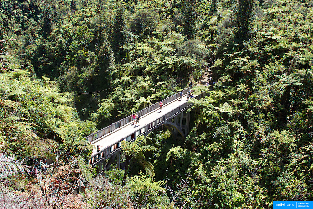 The Bridge to Nowhere is a concrete road bridge spanning the Mangapurua Stream in Whanganui National Park, North Island, New Zealand. It has no roads leading to it, but it is a popular tourist attraction, accessible by boat or kayak, followed by a 45 minute (one way) walk along maintained bush trails..It was built across the deep Mangapurua Gorge to provide access to an area where the government was opening up land in 1917 for pioneering farmers, mainly soldiers who had returned from World War I. The intention was to build roads to it later, but the area proved to be so remote and unsuitable for farming that the venture failed and the farms reverted to native bush. 30th December 2010. PhotoTim Clayton.
