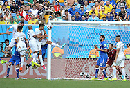 Diego God&iacute;n (far left) of Uruguay scores the only goal of the game during the 2014 FIFA World Cup match at Arena das Dunas, Natal<br /> Picture by Stefano Gnech/Focus Images Ltd +39 333 1641678<br /> 24/06/2014