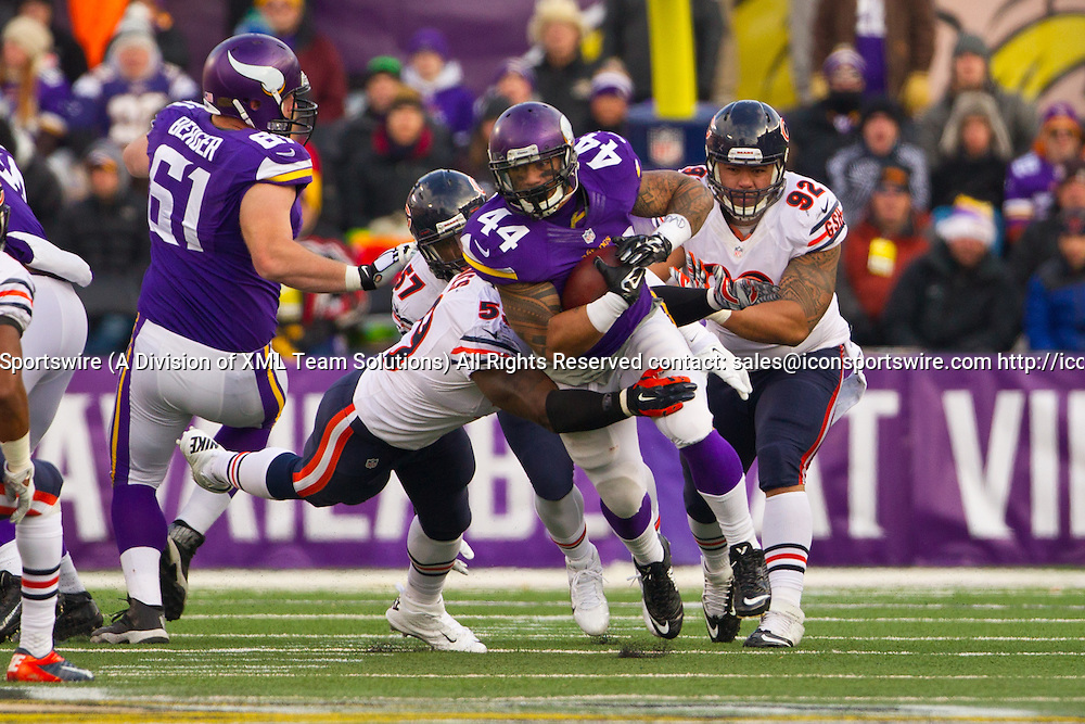 Dec 28, 2014: Chicago Bears Linebacker Christian Jones (59) [11411] wraps up Minnesota Vikings Running Back Matt Asiata (44) [15078] in the 2nd half.<br /> The Vikings beat the Bears 13-9 at TCF Bank Stadium in Minneapolis, MN.