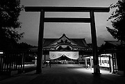 People pray at the main hall of Yasukuni Shrine in Tokyo, Japan. Every year on August 15, the day Japan officially surrendered WWII, tens of thousands of Japanese visit the controversial shrine to pay their respects to the 2.46 million war dead enshrined there, the majority of who are soldiers and others killed in WWII but also includes 14 Class A convicted war criminals, such as Japan's war-time prime minister Hideki Tojo. Each year speculation escalates as to whether the country's political leaders will visit the shrine, the last to do so being Junichiro Koizumi in 2005. Nationalism in Japan is reportedly on the rise, while sentiment against the nation by countries that suffered from Japan's wartime brutality, such as China, has been further aggravated by Japan's insistence on glossing over its wartime atrocities in school text books..Photographer:Robert Gilhooly..