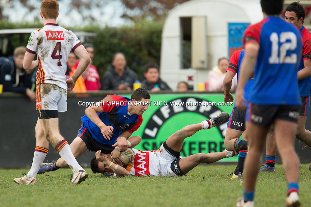NSW's Jayden Connors brought down during the rugby league match between Upper Central Zone U18 and NSW Country U18, at Puketawhero Park, Rotorua, New Zealand, Saturday 13 July 2013.  Photo: Stephen Barker/photosport.co.nz