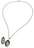 black and white photo locket on a silver chain necklace