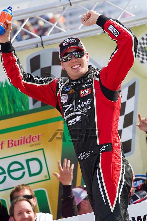 BRISTOL, TN - MAR 19, 2011:  Kyle Busch (18) wins the Scotts EZ Seed 300 race at the Bristol Motor Speedway in Bristol, TN.