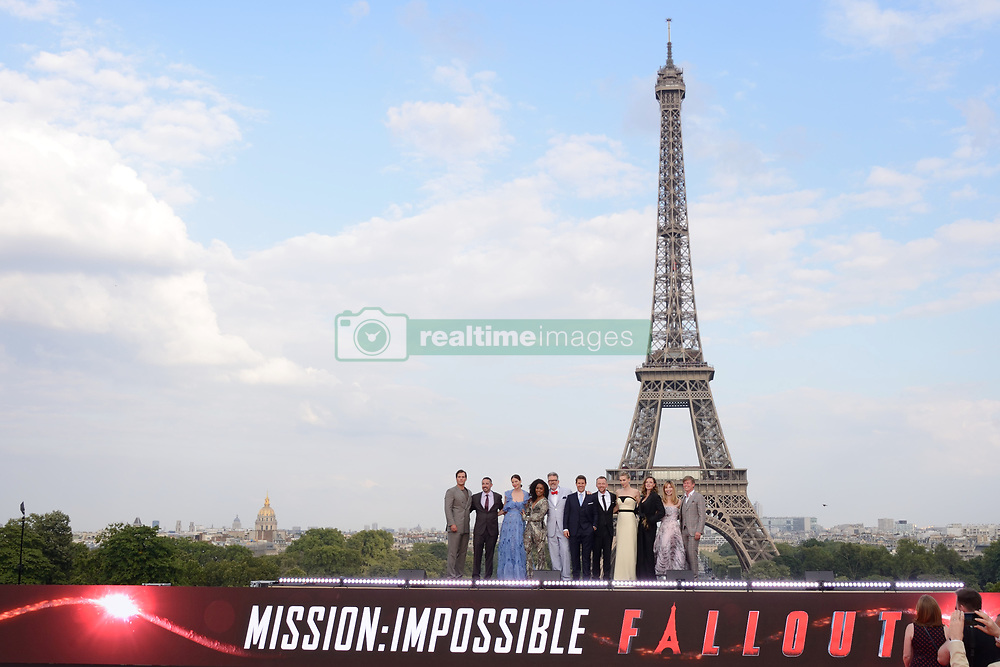 Henry Cavill, Jake Myers, Michelle Monaghan, Angela Bassett, Christopher McQuarrie, Tom Cruise, Simon Pegg, Vanessa Kirby, Rebecca Ferguson, Alix Benezech and Caspar Phillipson pose in front of the Eiffel Tower during the Global Premiere of Mission: Impossible - Fallout at Palais de Chaillot in Paris, France on July 12, 2018. Photo by Aurore Marechal/ABACAPRESS.COM