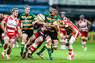 Calum Clark of Northampton Saints (centre) leading the charge during the Aviva Premiership match at Franklin's Gardens, Northampton<br /> Picture by Andy Kearns/Focus Images Ltd 0781 864 4264<br /> 05/09/2014