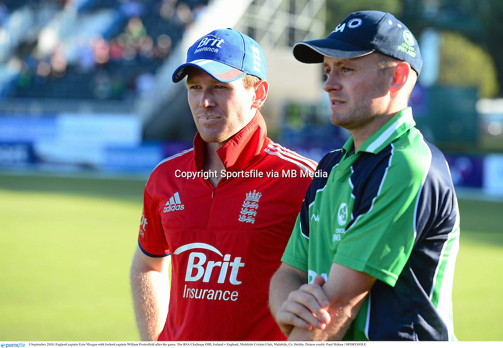 3 September 2013; England captain Eoin Morgan with Ireland captain William Porterfield after the game. The RSA Challenge ODI, Ireland v England, Malahide Cricket Club, Malahide, Co. Dublin. Picture credit: Paul Mohan / SPORTSFILE