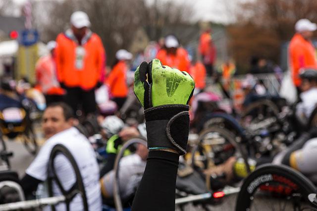 hand cycle athlete raised fist before start