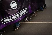 Frankfurt | 25 February 2017<br /> <br /> Am Samstag (25.02.2017) nahmen etwa 1000 Menschen in Frankfurt am Main an einer linksradikalen Demonstration unter dem Motto &quot;Make Racists Afraid Again&quot; Teil. Die Demo begann am S&uuml;dbahnhof in Frankfurt-Sachsenhausen und endete am Willy-Brandt-Platz. Organisiert wurde der Aufmarsch von dem B&uuml;ndnis &quot;Antifa United Frankfurt&quot;.<br /> Hier: Antifa-Aktivisten (Aktivistinnen) hinter einem Transparent mit der Aufschrift &quot;Antifa United Frankfurt&quot; und einem Logo &quot;Antifaschistische Aktion&quot;, viele tragen Sneakers von Nike und NB New Balance.<br /> <br /> photo &copy; peter-juelich.com