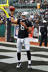 Sep 25, 2011; Oakland, CA, USA;  Oakland Raiders quarterback Jason Campbell (8) warms up before the game against the New York Jets at O.co Coliseum.