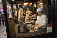 Cook preparing food at street side in Tokyo