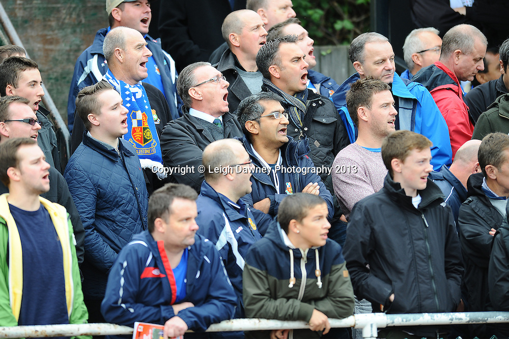Wealdstone supporters chant during the match. Hornchurch v Wealdstone at The Stadium, Bridge Avenue, Upminster, Essex. FA Cup 3rd Qualifying Round tie. © Leigh Dawney Photography 2013.