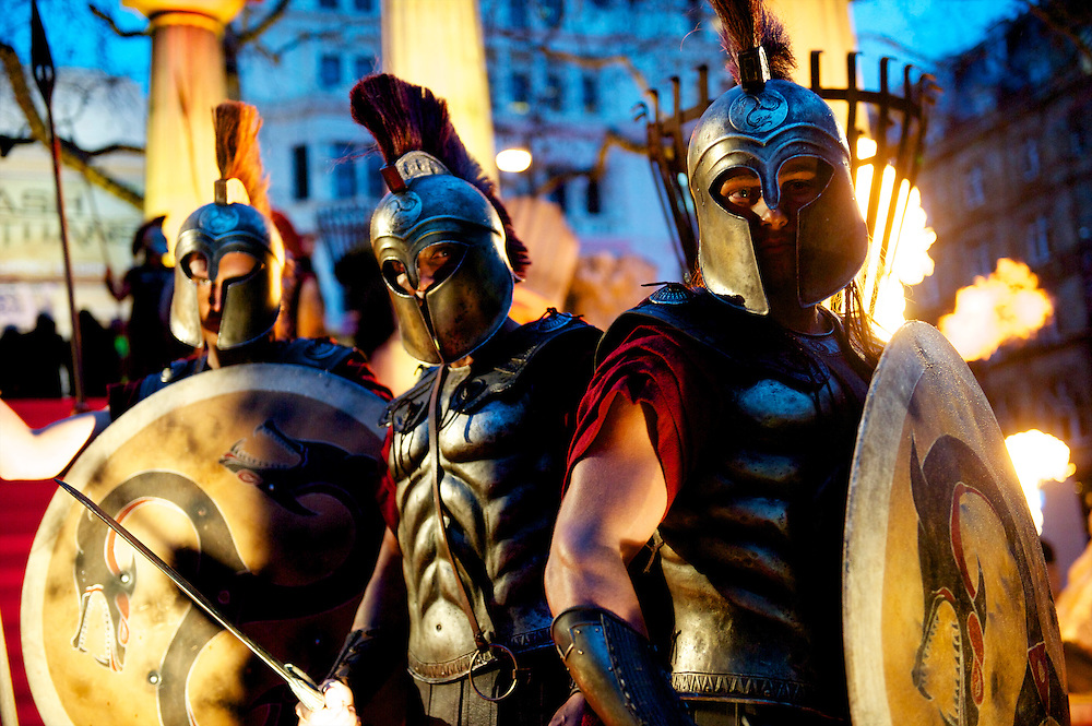 "Greek sentries pose for a portrait at the world premiere of ""The Clash of the Titans,"" a remake of the 1981 film, at Empire Leicester Square, London.  With a narrative inspired by the Greek myth of Perseus, Leicester Square was transformed into a ancient Greek setting, complete with a legion of soldiers, columns and scultpture ruins."