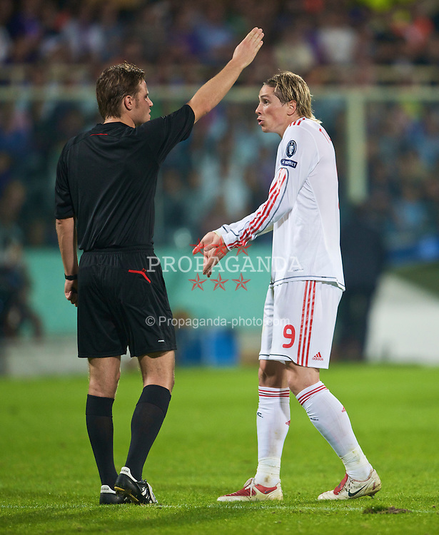 FLORENCE, ITALY - Tuesday, September 29, 2009: Liverpool's Fernando Torres argues with referee Feliz Brych during the UEFA Champions League Group E match against Fiorentina at the Artemio Franchi. (Pic by David Rawcliffe/Propaganda)