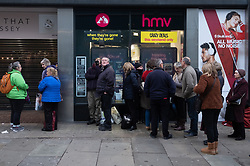 © Licensed to London News Pictures. 23/11/2018. London, UK.  Shoppers queue outside a HMV record store store waiting to open in Oxford Street at the beginning of Black Friday sales. Photo credit: Ray Tang/LNP