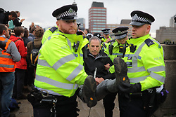 © Licensed to London News Pictures. 07/10/2019. London, UK. Extinction Rebellion protesters block Lambeth Bridge in Westminster. Activists will converge on Westminster blockading roads in the area for at least two weeks calling on government departments to 'Tell the Truth' about what they are doing to tackle the Climate Emergency. Photo credit: Rob Pinney/LNP