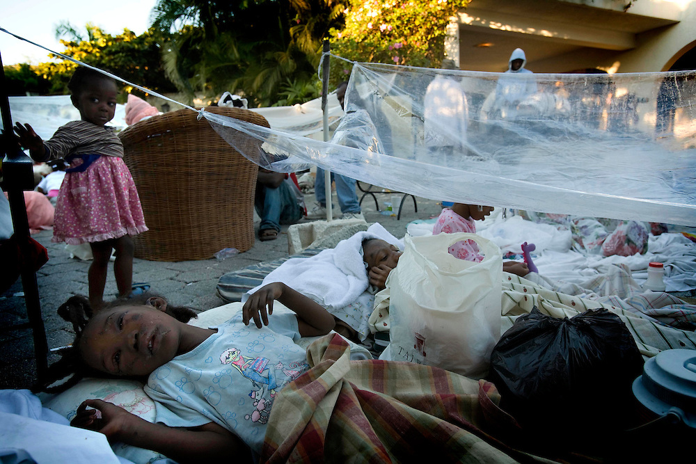 Injured people gathered outside the La Villa Creole Hotel after an earthquake measuring 7.0 rocked Port-au-Prince, Haiti on Thursday January 14, 2010. They received first aid by volunteers of the hotel staff and from doctors of the organization, Hope for Haiti.