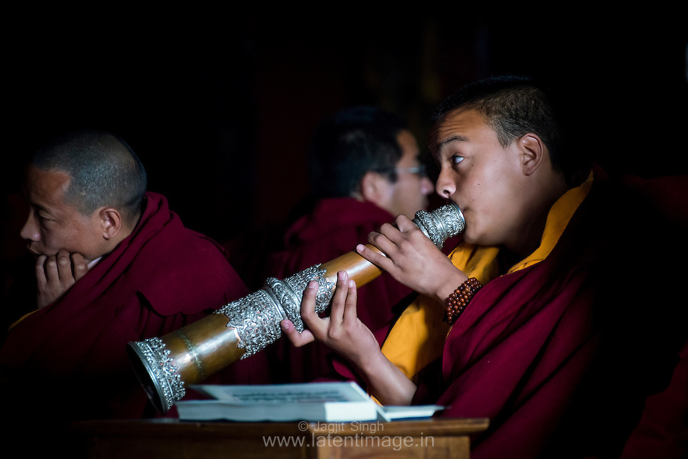 SONAM NYIMA a monk from Sikkim, playing a ritual sound instrument during the ritual prayer in a religious ceremony at the Tibetan YungDrung Bon Monastery at Dolanji.