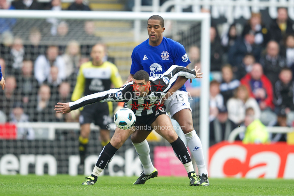 NEWCASTLE, ENGLAND - Saturday, March 5, 2011: Everton's Sylvain Distin and Newcastle United's Leon Best during the Premiership match at St. James' Park. (Photo by David Rawcliffe/Propaganda)
