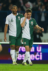 OSIJEK, CROATIA - Tuesday, October 16, 2012: Wales' captain Ashley Williams and Joe Allen look dejected as Croatia score the opening goal during the Brazil 2014 FIFA World Cup Qualifying Group A match at the Stadion Gradski Vrt. (Pic by David Rawcliffe/Propaganda)