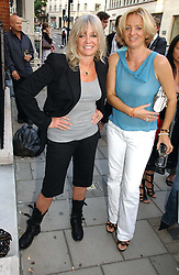 Left to right, JO WOOD and ALICE BEER at a private view of artist Damian Elwes work 'Artists Studios' held at Scream, 34 Bruton Street, London W1 on 29th June 2006.<br />