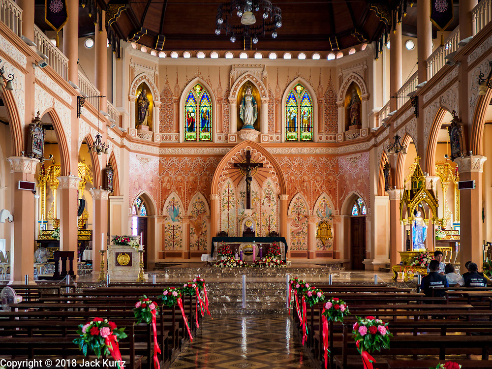 23 DECEMBER 2018 - CHANTABURI, THAILAND:  Inside the Cathedral of the Immaculate Conception in Chantaburi. It is the largest Catholic church in Thailand and was founded more than 300 years ago by Vietnamese Catholics who emigrated to Thailand. The current cathedral building was sited and construction started while Chantaburi was occupied by French forces that had occupied neighboring Cambodia. The cathedral was finished after the French were expelled from Thailand. Chantaburi is the capital city of Chantaburi province on the Chantaburi River. Because of its relatively well preserved tradition architecture and internationally famous gem market, Chantaburi is a popular weekend destination for Thai tourists.   PHOTO BY JACK KURTZ