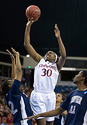 March 29, 2010; Sacramento, CA, USA; Stanford Cardinal forward Nnemkadi Ogwumike (30) shoots over Xavier Musketeers forward April Phillips (42) during the first half in the finals of the Sacramental regional in the 2010 NCAA womens basketball tournament at ARCO Arena. Stanford defeated Xavier 55-53.