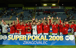 Ermin Rakovic, captain of Interblock with a cup (at left coach Dragan Skocic) at Slovenian Supercup between NK Domzale and NK Interblock, on July 9, 2008, in Domzale. Interblock won the mach and Supercup by 7 : 6 after penalty shots. (Photo by Vid Ponikvar / Sportal Images)