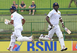 August 14, 2017 - Colombo, Sri Lanka - Sri Lankan cricket captain Dinesh Chandimal and Angelo Mathews run between the wickets during the 3rd Day's play in the 3rd and final Test match between Sri Lanka and India at the Pallekele international cricket stadium at Kandy, Sri Lanka on MOnday 14 August 2017. (Credit Image: © Tharaka Basnayaka/NurPhoto via ZUMA Press)