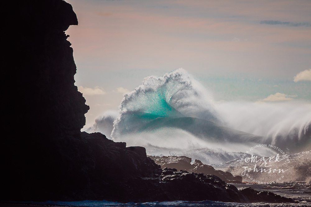 Large winter storm surf breaking off the Na Pali coast, Kauai, Hawaii