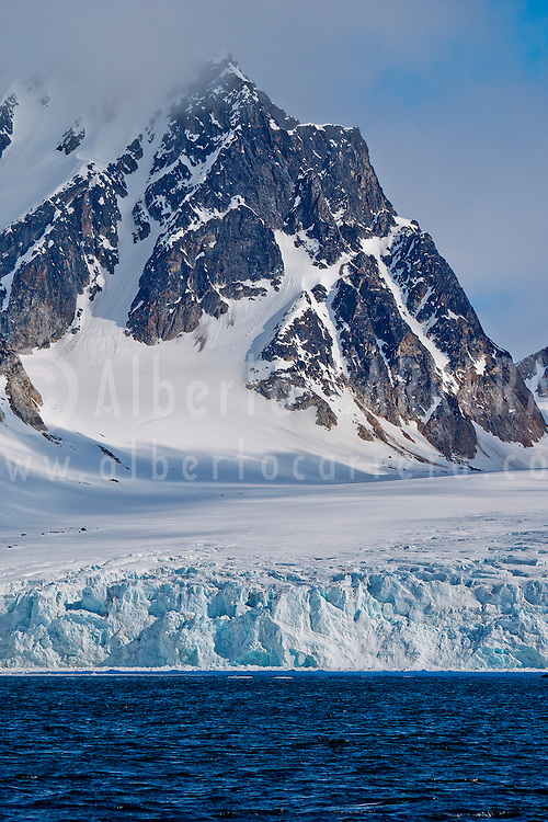 Alberto Carrera, Arctic Lands, Deep Blue Glacier and Snowcapped Mountains, Albert I Land, Arctic, Spitsbergen, Svalbard, Norway, Europe