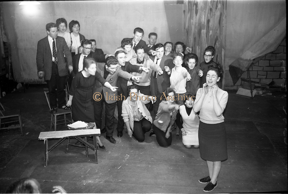 "14/09/1964<br /> 09/14/1964<br /> 14 September 1964<br /> Rehearsal for ""An Triail"" by Mired Ní Ghrada, which Gael-Linn presented at Damer Hall from the 22/09/1964. It was the only Irish Language contribution to the Dublin Theatre Festival that year. Play was produced by Tomás Mac Anna. Image shows a scene from the play."