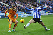 Wolverhampton Wanderers midfielder James Henry crosses ball blocked by Kieran Lee of Sheffield Wednesday  during the Sky Bet Championship match between Sheffield Wednesday and Wolverhampton Wanderers at Hillsborough, Sheffield, England on 20 December 2015. Photo by Ian Lyall.