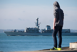 © Licensed to London News Pictures. 27/10/2017. Portsmouth, UK.  A teenager looking out to The Solent from Southsea Promenade as HMS Westminster sails out of Portsmouth in the sunny and calm autumn weather on today, 27th October 2017.  Photo credit: Rob Arnold/LNP