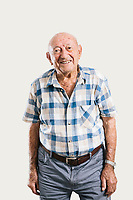 ACCIAROLI, ITALY - 14 SEPTEMBER 2018: Giuseppe Vassallo (95) poses for a portrait in his home in Acciaroli, a small fishing village in the municipality of Pollica, Italy, on September 14th 2018. Giuseppe Vassallo was an Italian Navy official during WWII. At age 86, 8 years ago, Mr Vassallo had multiple sex affairs to overcome his depression following his wife's death. He was a testimonial of the Acciaroli's mediterranean diet and lifestyle during Expo 2015, the Universal Exposition hostel in Milan last year.<br /> <br /> To understand how people can live longer throughout the world, researchers at University of California, San Diego School of Medicine have teamed up with colleagues at University of Rome La Sapienza to study a group of 300 citizens, all over 100 years old, living in Acciaroli (Pollica), a remote Italian village nestled between the ocean and mountains in Cilento, southern Italy.<br /> <br /> About 1-in-60 of the area's inhabitants are older than 90, according to the researchers. Such a concentration rivals that of other so-called blue zones, like Sardinia and Okinawa, which have unusually large percentages of very old people. In the 2010 census, about 1-in-163 Americans were 90 or older.