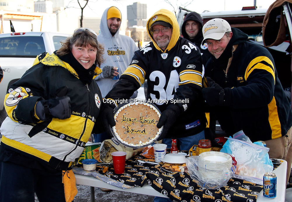 """Pittsburgh Steelers fans tailgate while sporting a pie stating that the Steelers are """"Super Bowl Bound"""" before the NFL 2011 AFC Championship playoff football game against the New York Jets on Sunday, January 23, 2011 in Pittsburgh, Pennsylvania. The Steelers won the game 24-19. (©Paul Anthony Spinelli)"""